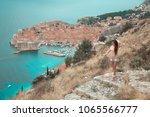 brunette girl tourist visiting... | Shutterstock . vector #1065566777