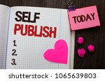 Small photo of Conceptual hand writing showing Self Publish. Business photo showcasing Publication Write Journalism Manuscript Article Facts written on Notebook Book on wooden background Today Heart.