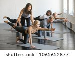 young female yoga instructor... | Shutterstock . vector #1065652877