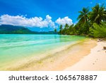 beautiful beach with turquoise... | Shutterstock . vector #1065678887