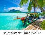 touristic motorized boat docked ... | Shutterstock . vector #1065692717
