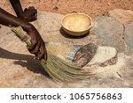 an african woman using her...   Shutterstock . vector #1065756863