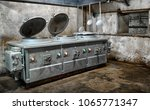 old kitchen in an abandoned... | Shutterstock . vector #1065771347