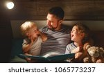 evening family reading. father... | Shutterstock . vector #1065773237