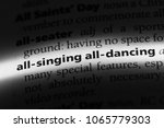 Small photo of all singing all dancing word in a dictionary. all singing all dancing concept.