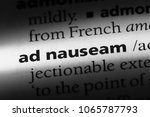 Small photo of ad nauseam word in a dictionary. ad nauseam concept.