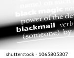 Small photo of blackmail word in a dictionary. blackmail concept.