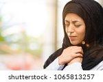 young arab woman wearing hijab... | Shutterstock . vector #1065813257