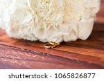 a closeup of two golden rings... | Shutterstock . vector #1065826877
