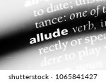 Small photo of allude word in a dictionary. allude concept.