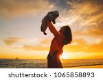 mother and baby silhouettes at... | Shutterstock . vector #1065858893