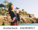 baby and mother on sea at... | Shutterstock . vector #1065858917