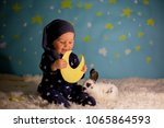 little child  baby boy with... | Shutterstock . vector #1065864593