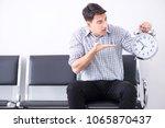 man nervously impatiently... | Shutterstock . vector #1065870437