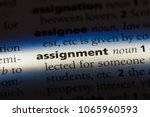 Small photo of assignment word in a dictionary. assignment concept.