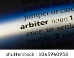 Small photo of arbiter word in a dictionary. arbiter concept.