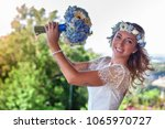 beautiful bride married at the... | Shutterstock . vector #1065970727