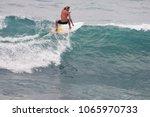 image of surfer on blue ocean... | Shutterstock . vector #1065970733