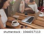two teenage women meet in... | Shutterstock . vector #1066017113