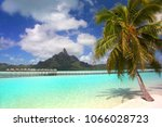 beautiful tropical beach with... | Shutterstock . vector #1066028723