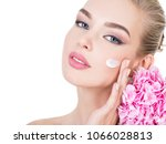 young woman touches cheek by... | Shutterstock . vector #1066028813