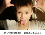 boy joking childlike prank... | Shutterstock . vector #1066051187