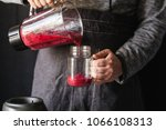 berry smoothie juicing making... | Shutterstock . vector #1066108313