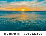 colorful tropical sunset... | Shutterstock . vector #1066122533