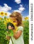 happy little girl smelling a... | Shutterstock . vector #1066186613