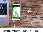 smartphone with white heart... | Shutterstock . vector #1066213103