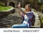 happy tourist is photographing...   Shutterstock . vector #1066221857