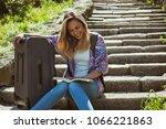 happy mid adult woman is going...   Shutterstock . vector #1066221863