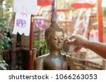 sprinkle water onto a buddha... | Shutterstock . vector #1066263053