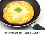 omelette of potato cooked in a frying pan - stock photo