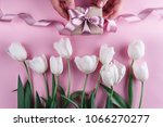 male hands holding a gift with... | Shutterstock . vector #1066270277