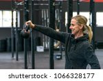 strong fit woman lifting a... | Shutterstock . vector #1066328177