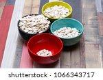 pumpkin seeds in colored bowls... | Shutterstock . vector #1066343717