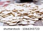 white raw pumpkin seeds on a... | Shutterstock . vector #1066343723