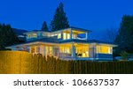 luxury house at night in... | Shutterstock . vector #106637537