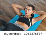 a woman at the gym trains by...   Shutterstock . vector #1066376597