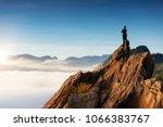 businessmen stand on high peaks ... | Shutterstock . vector #1066383767