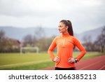 portrait of active young woman... | Shutterstock . vector #1066385213