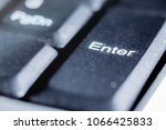 Small photo of on the keyboard of the laptop - a close-up key to enter, a symbol for entering and storing information