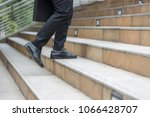 Small photo of bussiness person walk upstair in hurry movement