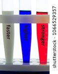 """Small photo of Olympic motto """"faster, higher, stronger"""" on test tubes of Russian flag colors"""