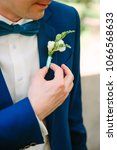stylish man groom in a blue... | Shutterstock . vector #1066568633