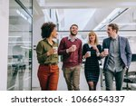 group of coworkers having a... | Shutterstock . vector #1066654337