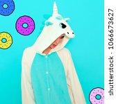 girl in pajamas unicorn. candy... | Shutterstock . vector #1066673627