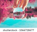 upside down hand holding a... | Shutterstock . vector #1066728677