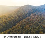 hinterland smokey sunset   Shutterstock . vector #1066743077